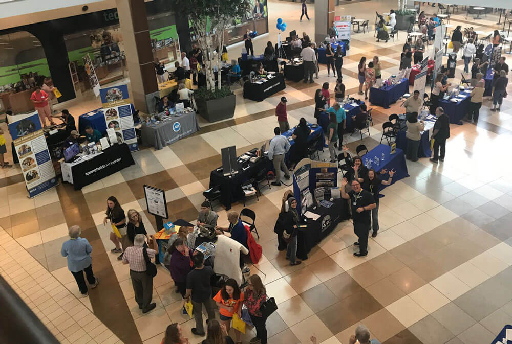 Bird eye view of various booths and visitors at Celebration Communication 2018