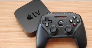 Apple Gaming Console on the top of wooden background